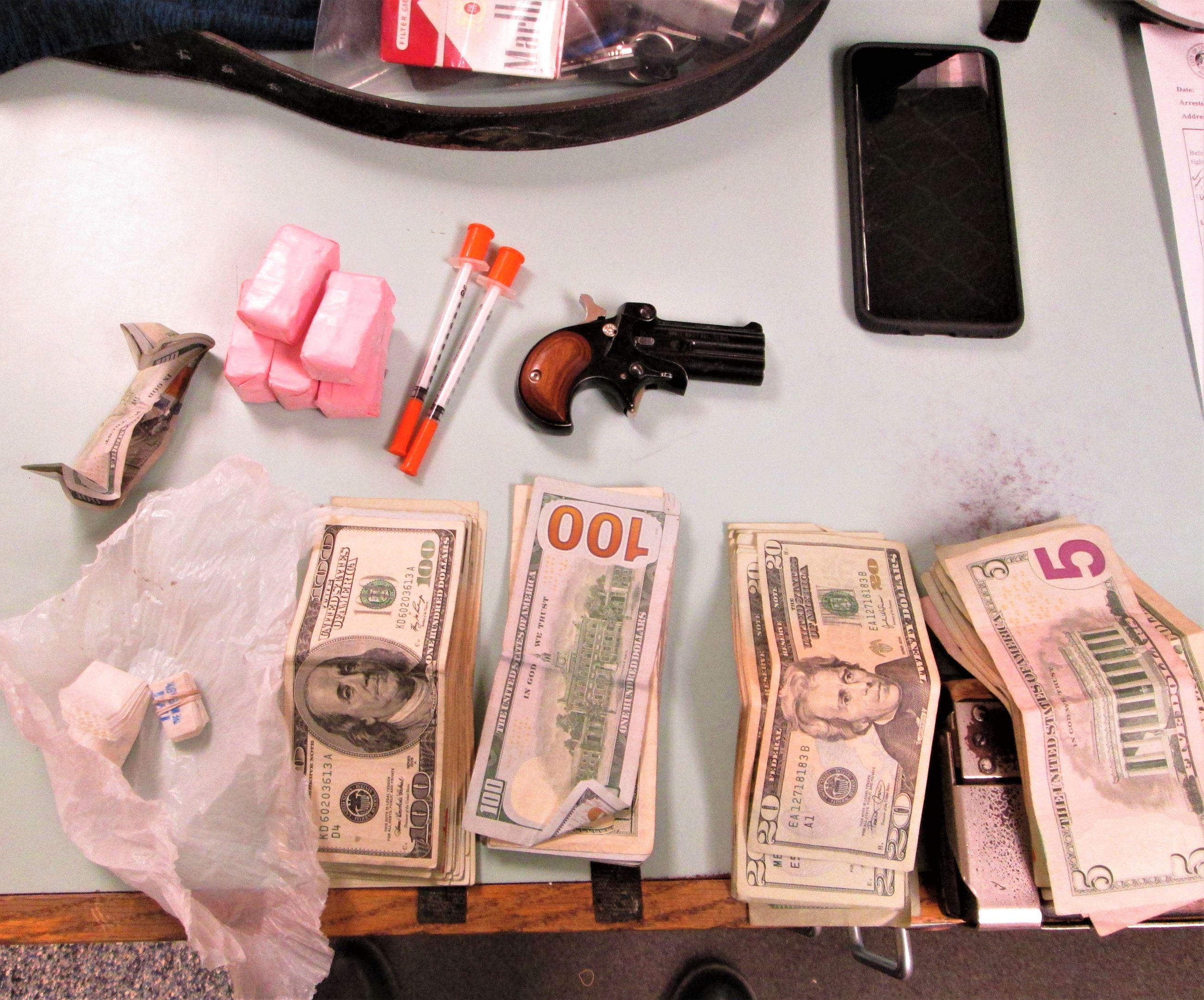 Photo of drugs, money, and pistol